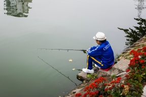 A man fishes in Truc Bach Lake. Let's hope it's catch-and-release; Hanoi's waters are incredibly polluted.